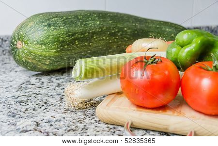 Fresh vegetables on cutting board in the kitchen
