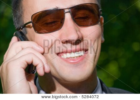 Young Happy Businessman Calling On Mobile Phone