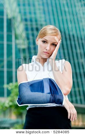Businesswoman With Injured Arm