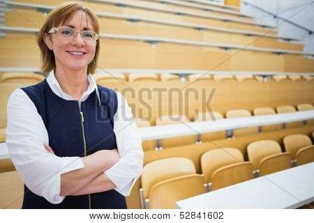 Portrait of an elegant female teacher standing in the lecture hall