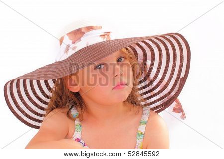 Attractive Little Girl In A Hat