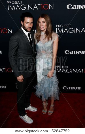 NEW YORK- OCT 24: Phil Winser (L) and Dree Hemingway attend the premiere of Canon's
