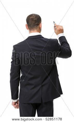 Backview of businessman writing something on the imaginary screen with marker, isolated on white