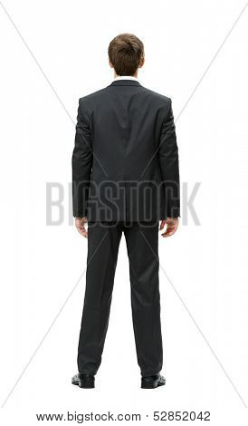 Full-length backview of businessman, isolated on white. Concept of leadership and success