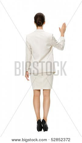 Full-length backview of businesswoman waving hand, isolated on white. Concept of leadership and success