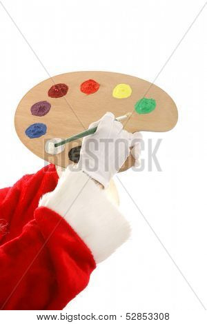 Santa's hands holding a paint palette and a paintbrush.  Isolated design element.