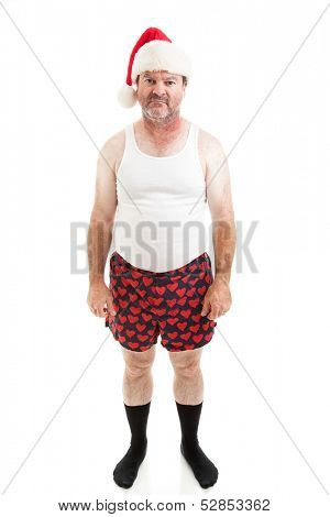 Unhappy, scruffy looking middle-aged man in his underwear, wearing a Santa hat for Christmas and looking upset.  Isolated on white.