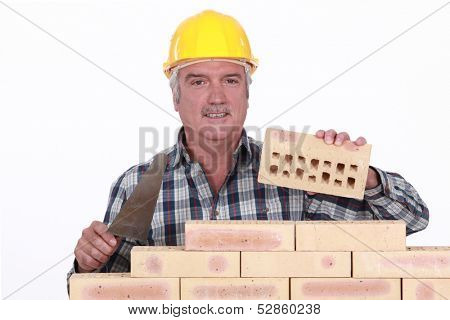 Bricklayer building wall