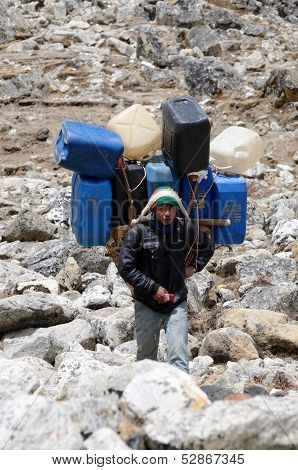 Sherpa porter carry heavy load in the Himalaya at Everest Base Camp trek,Nepal