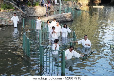 Yardenit, Israel - January 21: Christian pilgrims ritual baptism in the waters of the Jordan River in the days of the Feast of Holy Baptism 21 January 2012 at Pilgrim baptismal site Yardenit, Israel.