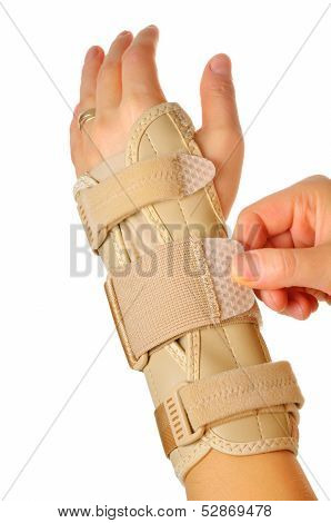 hand with a orthopedic wrist brace