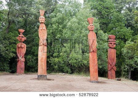 Group Of Mapuchean Totems At A Park In Temuco.