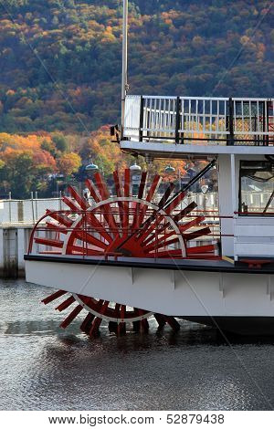 Red wheel of old steamboat