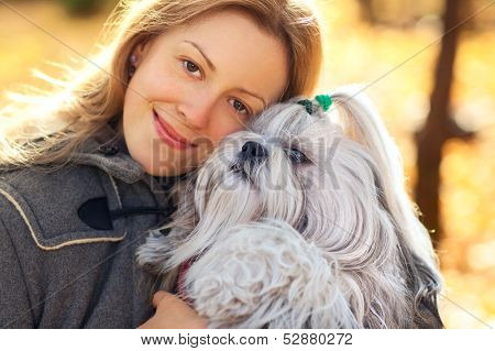 Young woman with favorite dog.