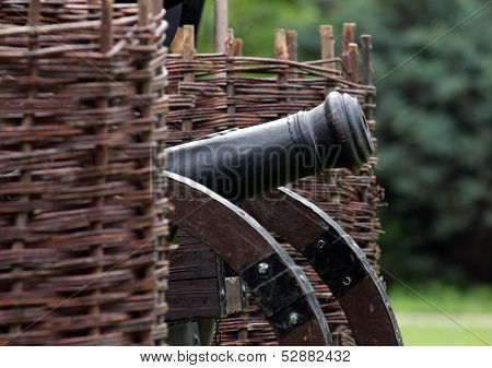 Old Cannon Standing Between Wicker Ramparts