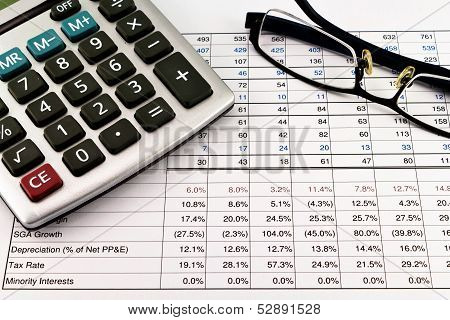 Financial Reports With Calculator And Glasses