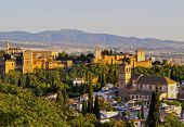 picture of cultural artifacts  - Cityscape of Granada with a view of famous Alhambra - a palace and fortress complex Andalusia Spain