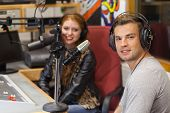 foto of interview  - Attractive cheerful radio host interviewing a guest in studio at college - JPG