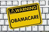 pic of mandates  - Computer keyboard keys with warning sign with words Affordable Healthcare Obamacare - JPG