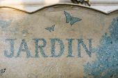 Retro Tin Can With Garden Jardin Inscription