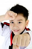 stock photo of taekwondo  - Taekwondo action by a asian cute boy isolate on white background - JPG