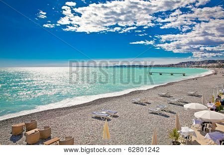 View of the beach in Nice, near the Promenade des Anglais, on summer hot day, France.