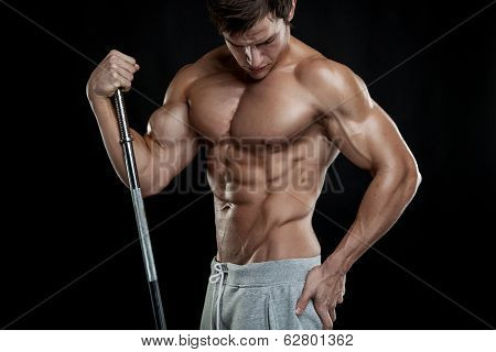 Muscular Bodybuilder Guy Doing Posing With Dumbbells Over Black Background