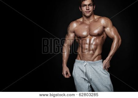 Strong Athletic Man Fitness Model Torso Showing Muscles Isolated On Black Background