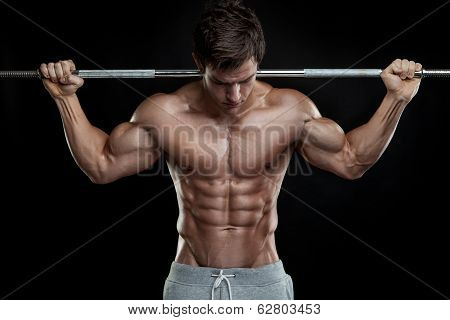 Muscular Bodybuilder Guy Doing Exercises With Dumbbells Over Black Background poster