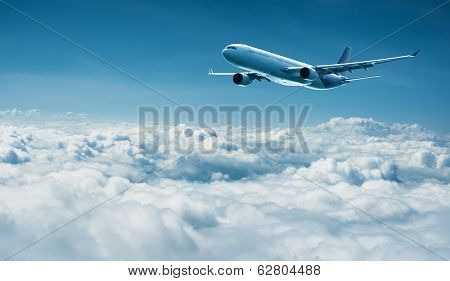 Airplane Flies Above Clouds - Air Travel