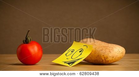 Potato with sticky post-it note reacting at tomato