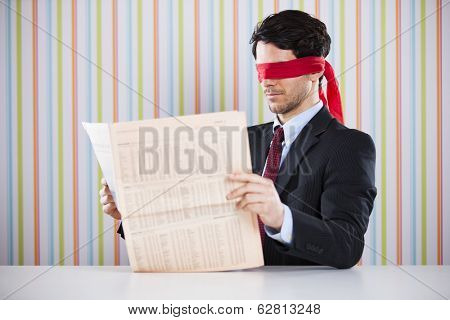 Blind reading a newspaper
