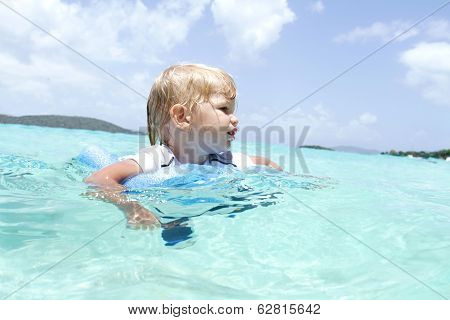 Baby Swimming In Tropical Ocean