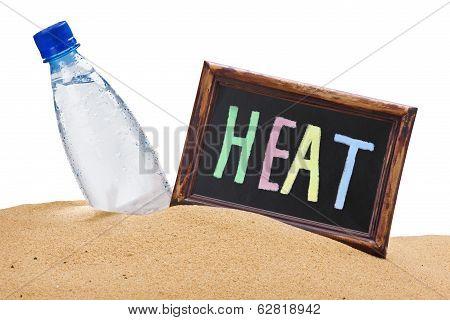 Bottle Of Water And A Blackboard