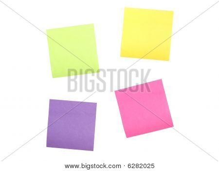 Four Scattered Post It Notes Far