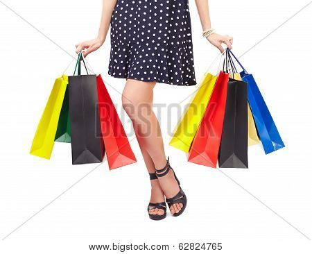 Waist-down View Of Woman With Shopping Bags