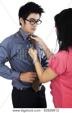 Man Dressing Up By Help His Assistant