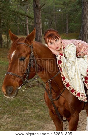 Beautiful Girl In Antique Dress On Horseback