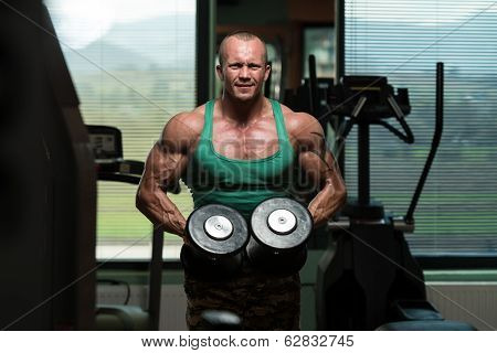 Bodybuilder Weight Lifting With Dumbbell