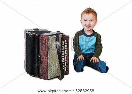 Little Boy Sitting Next To Accordion