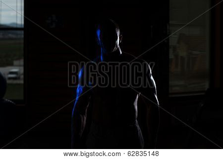Siluet Young Muscular Man Flexing Muscles