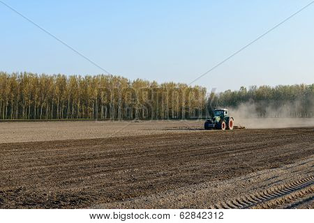 Tractor Harrowing Rice Field, Lomellina (italy)