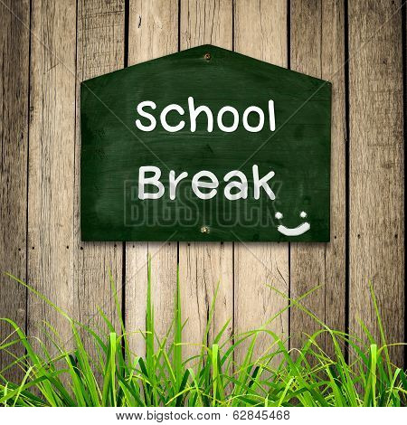 School Brak Message On Blackboard With Green Grass On Wooden Background.