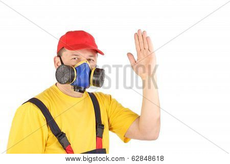 Worker in gas mask say hi.