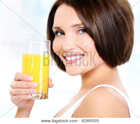 Beautiful Woman Holding Glass Of Orange Juice