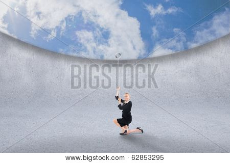 Composite image of businesswoman pulling down blue sky over grey room