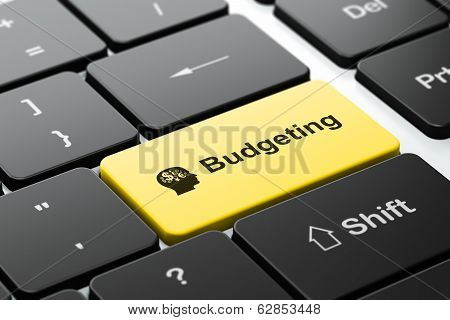 Finance concept: Head With Finance Symbol and Budgeting on computer keyboard background