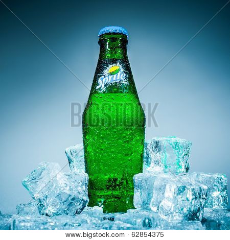 MOSCOW, RUSSIA-APRIL 4, 2014: Bottle of Coca Cola company soft drink Sprite on ice. It was introduced in the United States in 1961. This was Coke's response to the popularity of 7 Up.