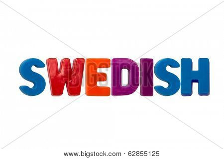 Letter magnets SWEDISH on white background
