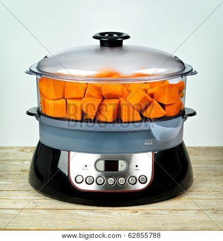 Healthy food in steamer, steam cooker with pumpkin
